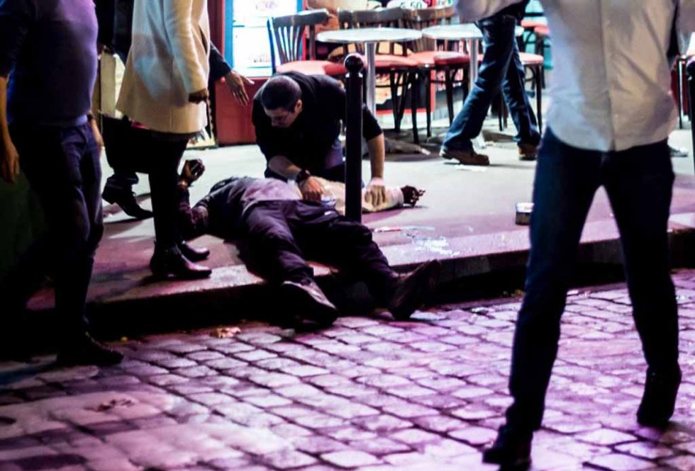 A man lies on the pavement outside the Cafe Bonne Bierre on the night of the November 13 attacks.