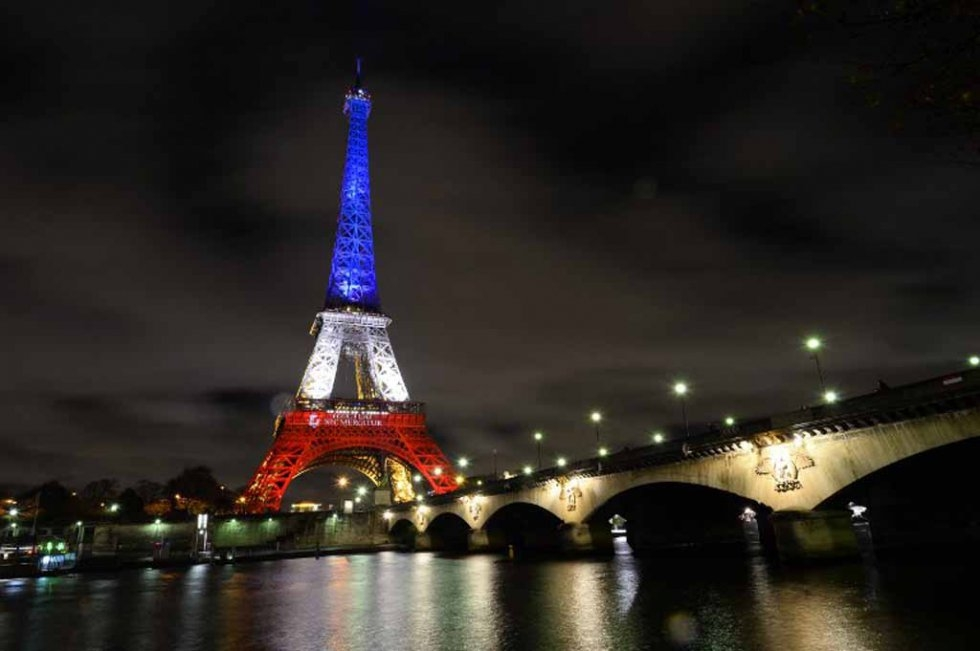 The Eiffel Tower lit up in the French tricolor in the days following the attacks.
