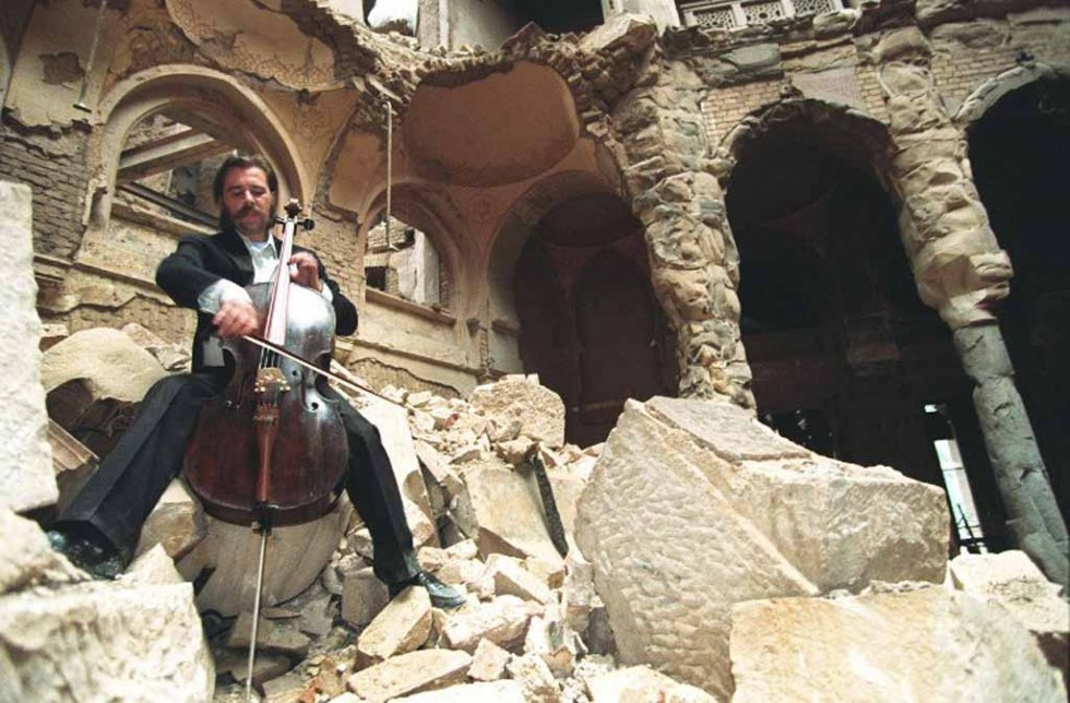 Cellist Vedran Smailovic plays Strauss in the bombed-out National Library in Sarajevo in September, 1992.