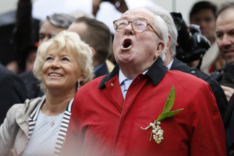 Jean-Marie Le Pen sings at the foot of a statue of Joan of Arc at a May 1 rally in Paris in 2015