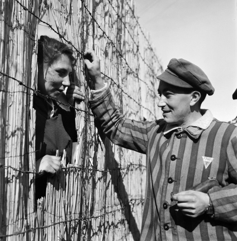 A prisoner chatting with a prostitute at the Nazi camp of Dachau in May 1945