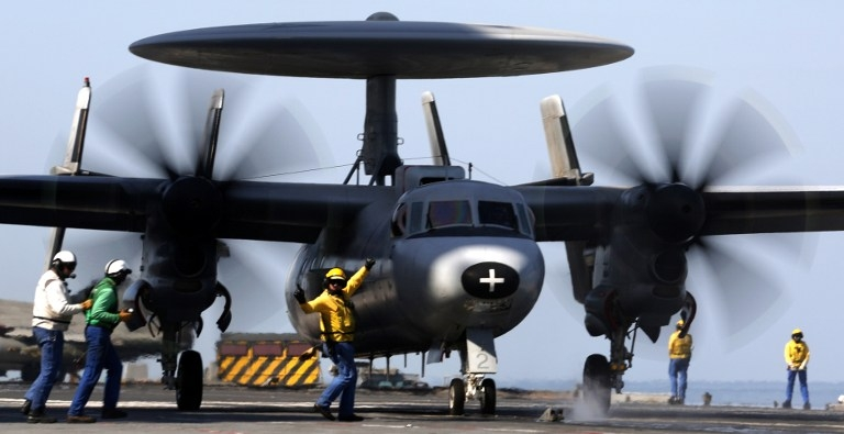 A French Navy Hawkeye prepares to take off from Charles de Gaulle on February 25, 2015