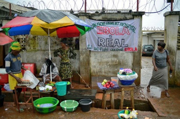 A sign warning of the dangers of ebola outside a hospital in Freetown on August 13, 2014