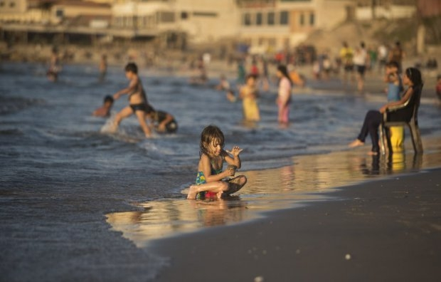 A child playing on the beach in Gaza City on September 7, 2014