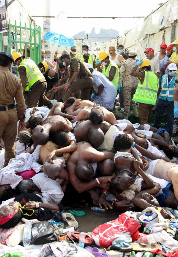 Bodies of stampede victims lie in the heat.