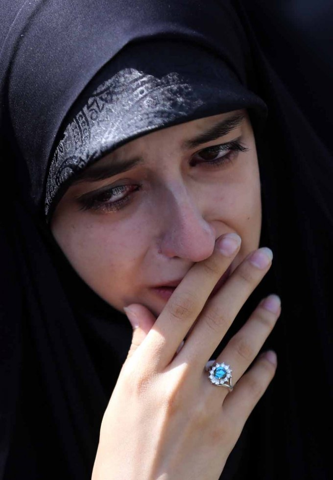 An Iranian woman mourns during a funeral procession for stampede victims.