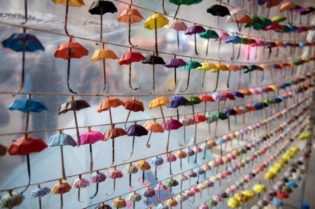 Small paper umbrellas are strung up in a display at the site of protests in the Causeway Bay area of Hong Kong on November 16, 2014 (AFP PHOTO / ALEX OGLE)
