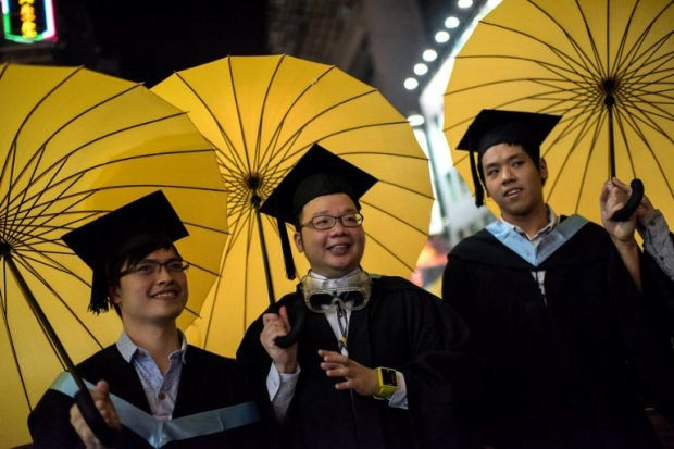 College students carry umbrellas, symbols of Hong Kong's protest movement, on October 19, 2014