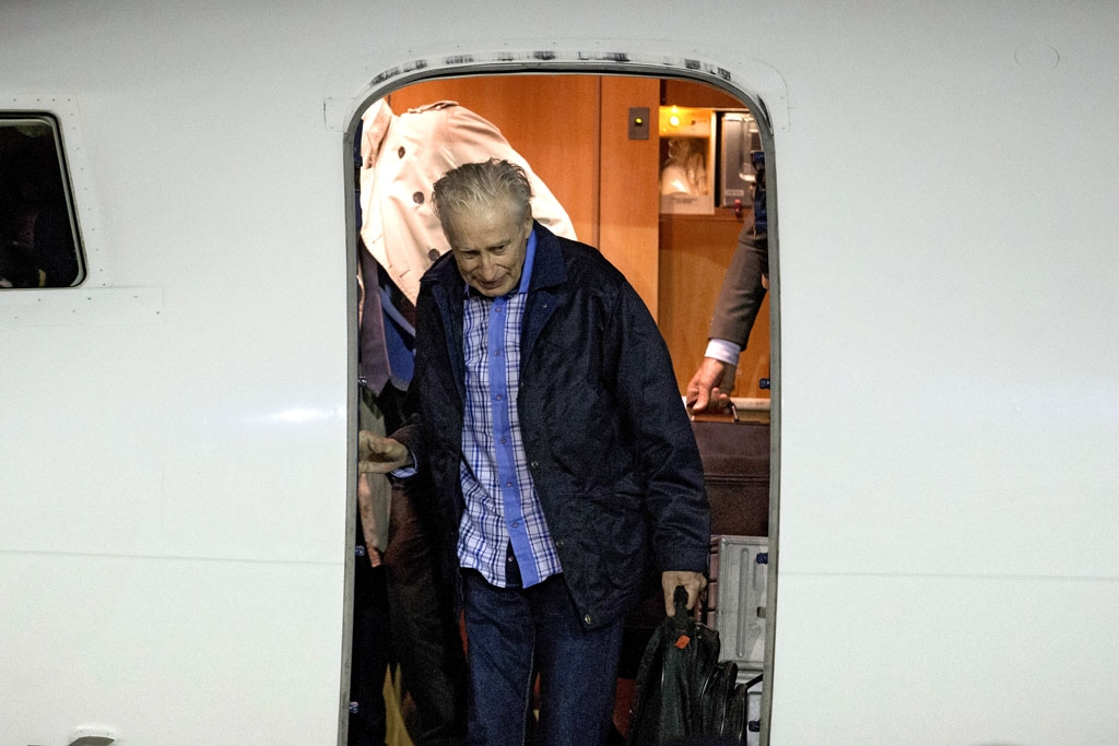 French former hostage Francis Collomp arrives in Paris, on November 18, 2013, the day after he escaped from the Islamist group Boko Haram