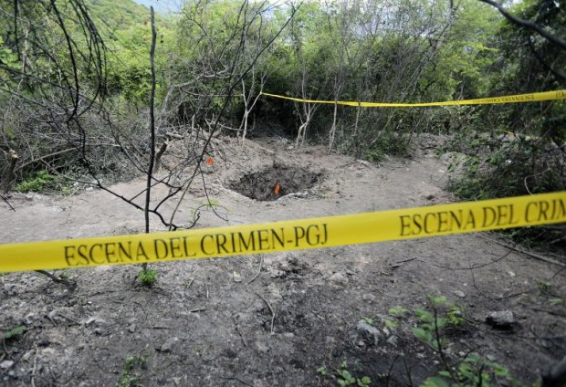 One of the mass graves discovered near Iguala on October 6, 2014