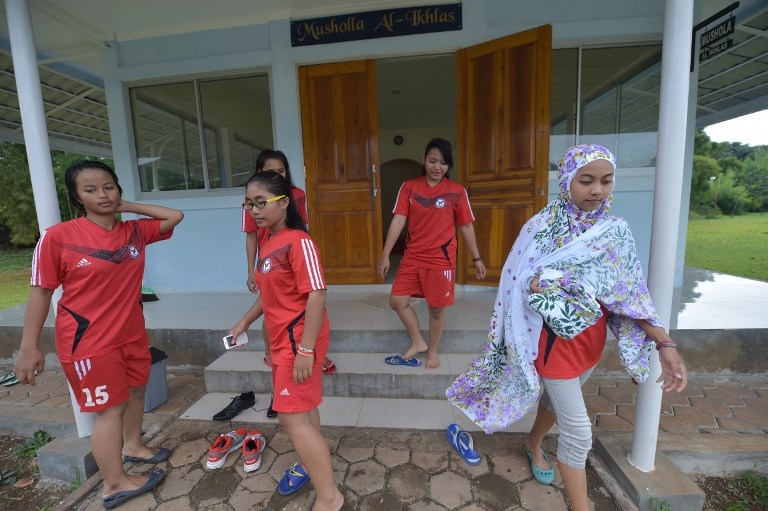 Women footballers leave the mosque before a training session in Jakarta on March 26, 2015