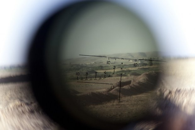 The frontline seen through a telescopic rifle belonging to a Kurdish Peshmerga sniper in the Gwer district, northern Iraq, on September 15, 2014