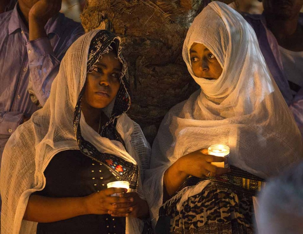 Members of the Eritrean community in Israel attend a memorial for an Eritrean asylum seeker who died of injuries after being shot by a guard and beaten by a mob after being mistaken for an attacker.