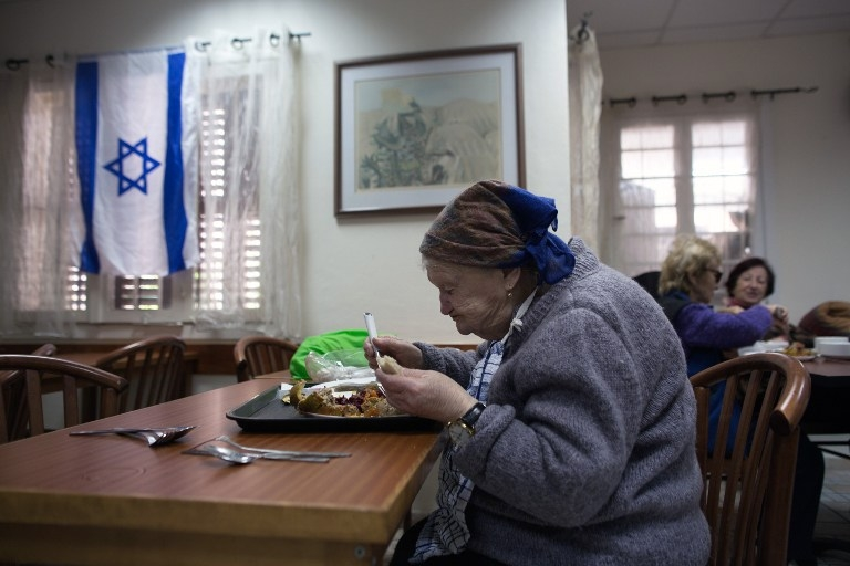 In the shared dining room on Haifa's 'Survivors' Street', on January 21, 2015