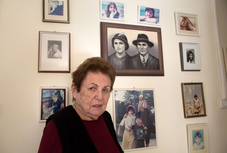 Judith Hershkowitz with a painting of her parents and relatives born in Israel on January 21, 2015
