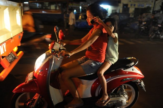A woman speaks on a mobile phone during the evening rush hour in Jakarta on January 2012