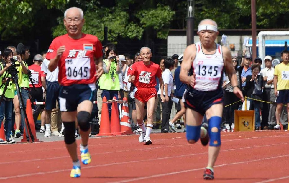 Hidekichi Miyazaki runs with the other competitors in the over-80 age group.