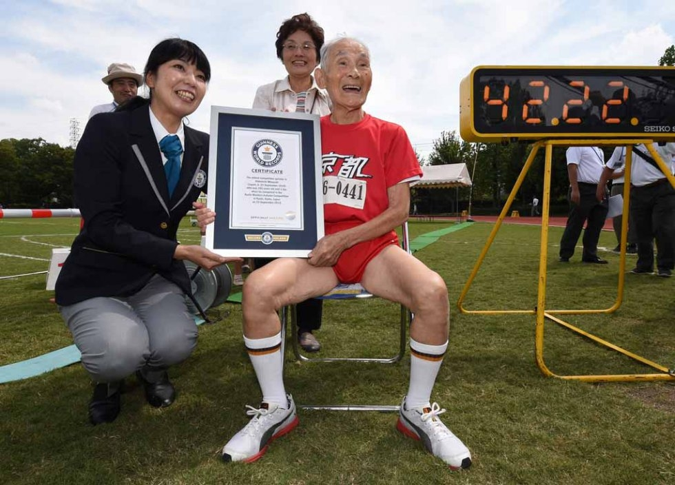 Hidekichi Miyzaki holds his certificate from Guinness World Records after setting his record in 100 metres in the over-105 age category.