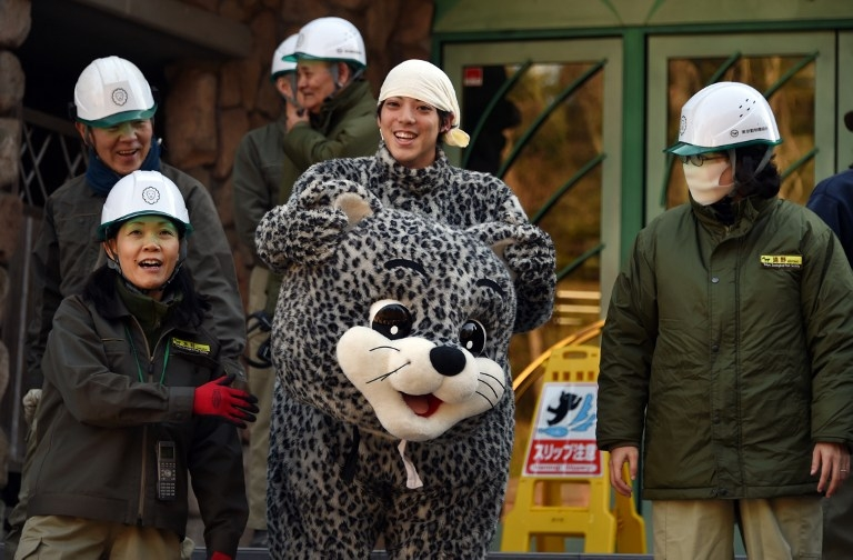 The 'leopard' reveals his identity after the Tama zoo escape drill on February 10, 2015