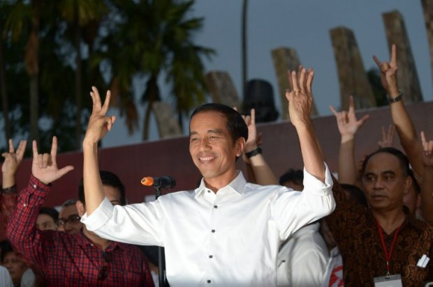 Indonesian President elect Joko Widodo greets supporters to celebrate his victory in Indonesia's election in Jakarta on July 23, 2014
