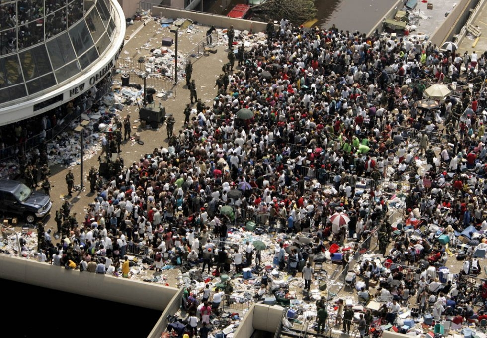 Thousands of people displaced by Hurricane Katrina await buses to depart the Superdome on September 2, 2005 in New Orleans, Louisiana