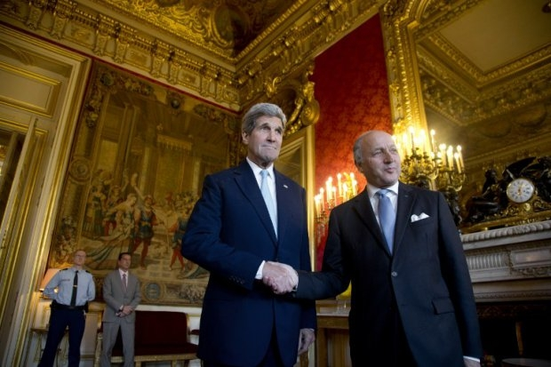 US Secretary of State John Kerry shakes hands with French Foreign Minister Laurent Fabius