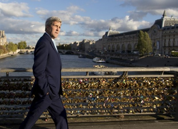 Kerry walks across the Seine in Paris on October 13, 2014