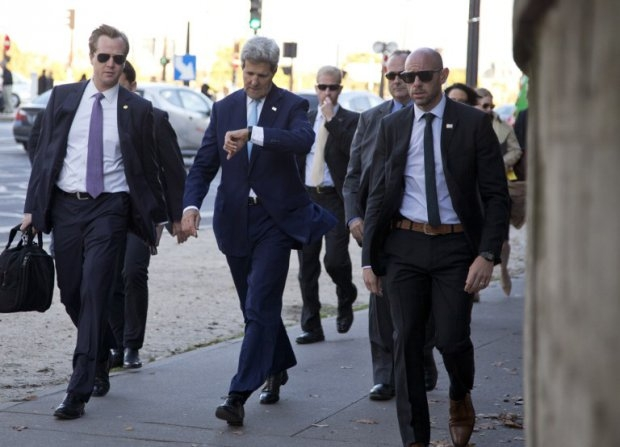 Kerry walks in downtown Paris with staff and security on October 13, 2014
