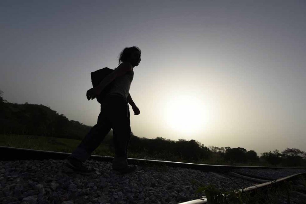 A migrant walks in Chacamax, Chiapas state, Mexico, on June 21, 2015