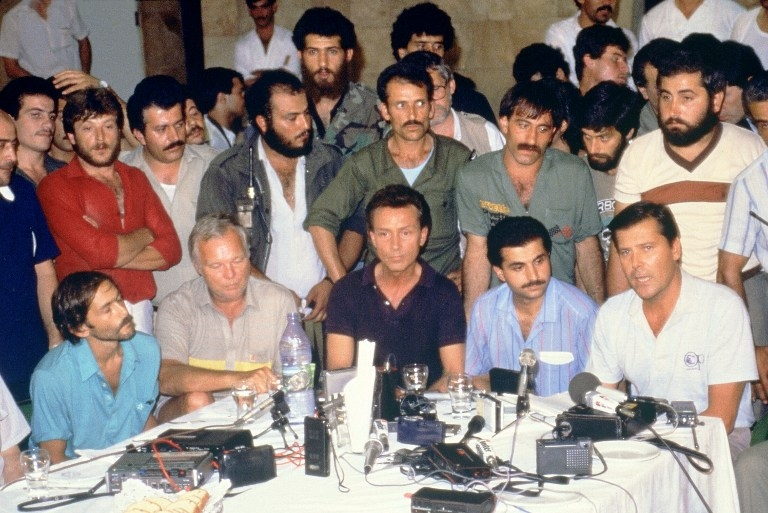 US hostages are presented to the press by their captors on June 20, 1985 at Beirut airport