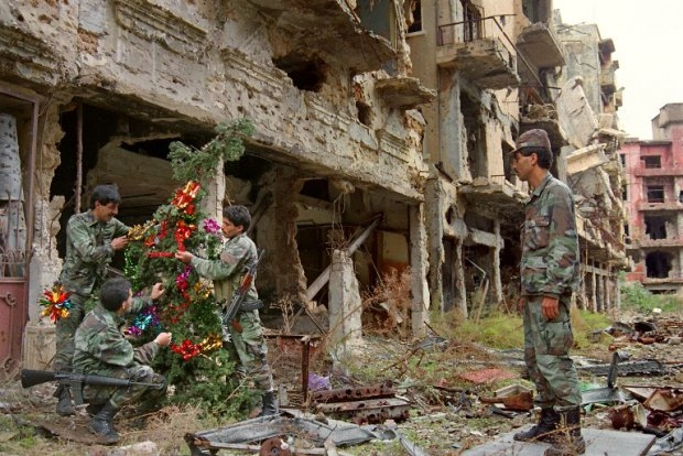 Muslim soldiers of the Lebanese Army set up a Christmas tree on the Green Line dividing Muslim west and Maronite Christian east Beirut, on December 23, 1987