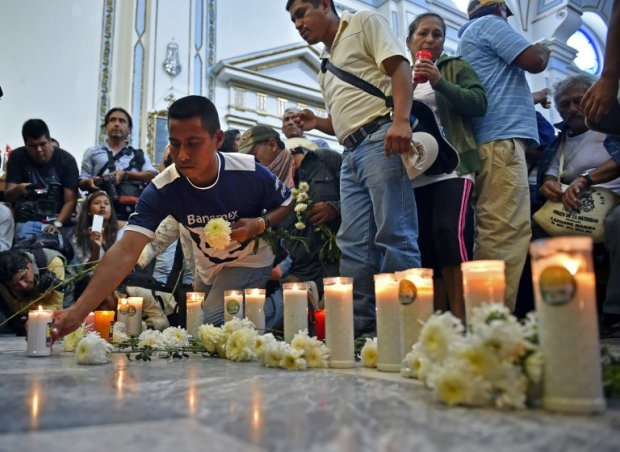 Relatives and mates of the 43 missing students take part in a mass at the Cathedral in Chilpancingo, Guerrero state on October 14, 2014 (AFP Photo / Yuri Cortez)