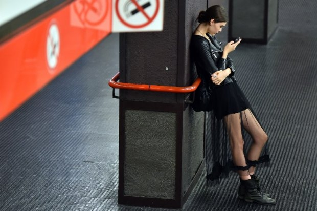 A model waits in a metro station after the Dolce & Gabbana show on September 21