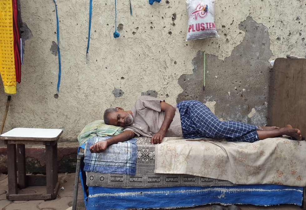 """I was a bit early for an assignment at Mumbai's famous red-light district of Kamathipura and so decided to walk around to look for some pics. I was ambling across when I saw this man sleeping blissfully while everything around him was awake and getting r"