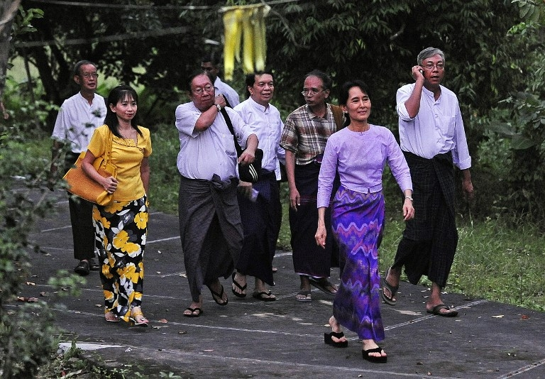 Suu Kyi walks to address her supporters outside the gates of her house after her release from house arrest in 2010.