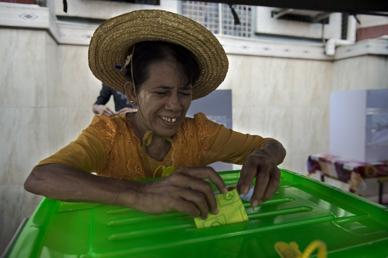 A woman smiles as she casts her ballot in the November 8 poll.