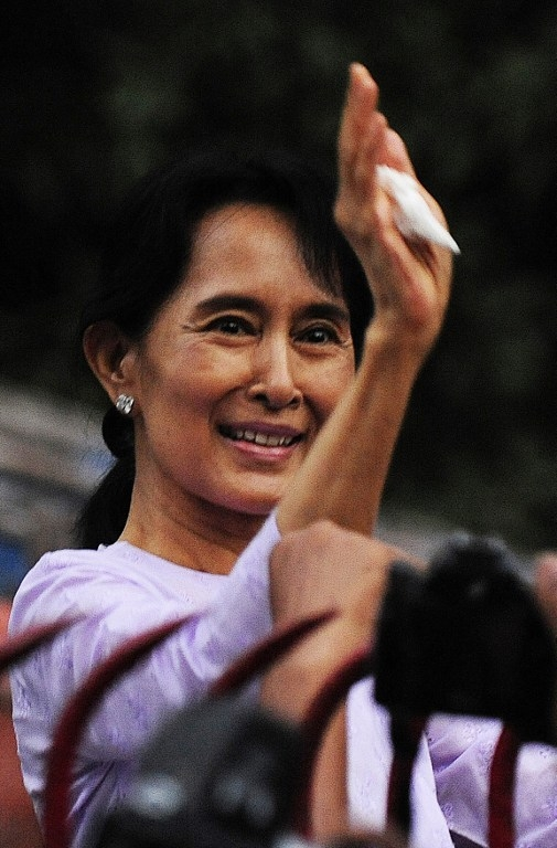 Aung San Suu Kyi waves to supporters after her release from house arrest in 2010.