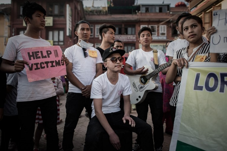 Students play music to raise funds for earthquake victims in Kathmandu on May 4, 2015