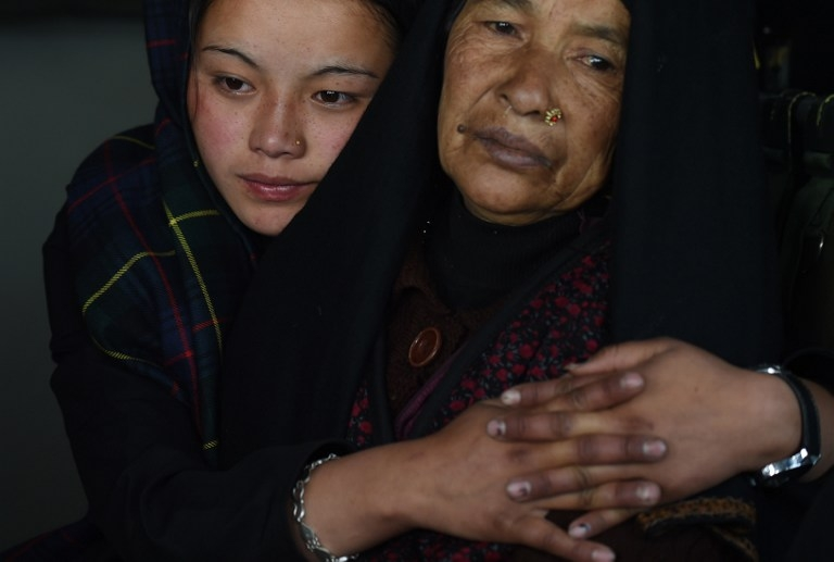 An injured Nepalese mother and daughter sit inside an Indian Army helicopter after being rescued from the north-central Laprak village on April 30, 2015