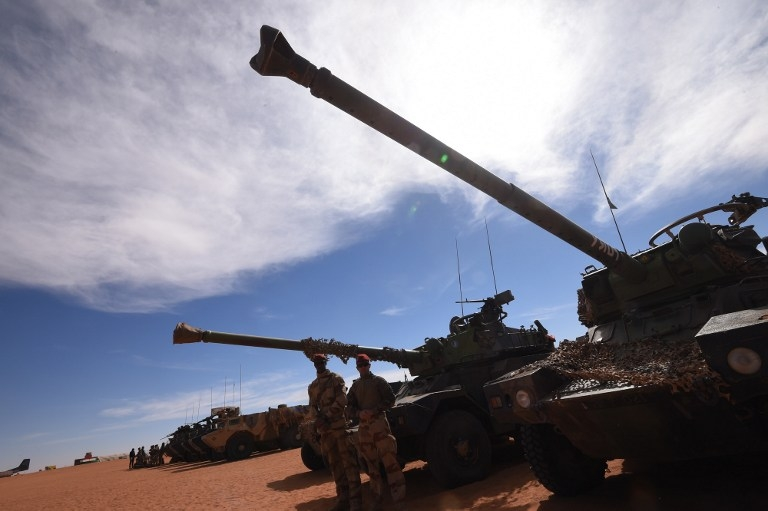 French soldiers in front of armoured vehicles in Madama, Niger on January 1, 2015