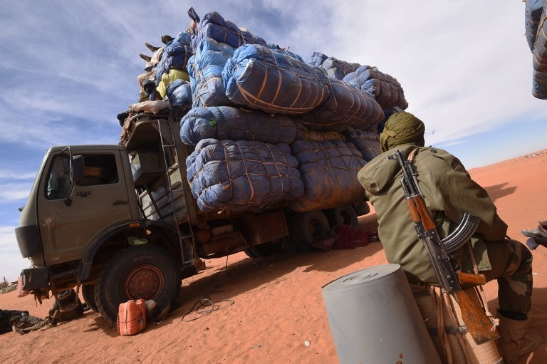 A Niger soldier waits near a truck belonging to sellers in Madama on January 1, 2015
