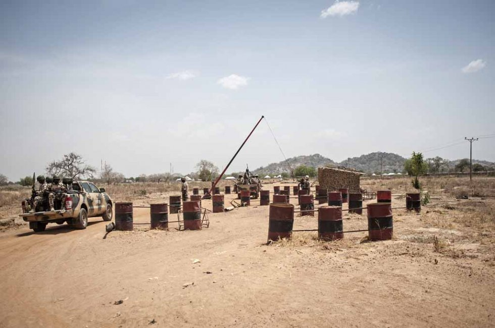 A military convoy passes through a checkpoint in Chibok in March, 2016.