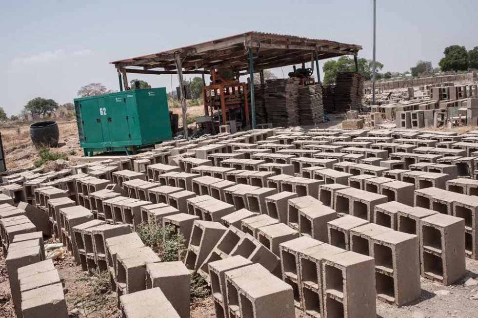 Bricks lie at the site of the school, waiting for the rebuilding to begin. March, 2016.