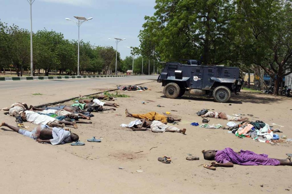 Bodies of suspected Boko Haram members lie on the road in Maiduguri after clashes with security forces. July, 2009.