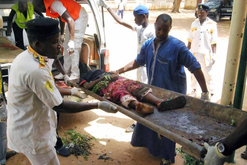 A victim of a bomb attack in northeast Nigeria is carried on a stretcher. June, 2015.