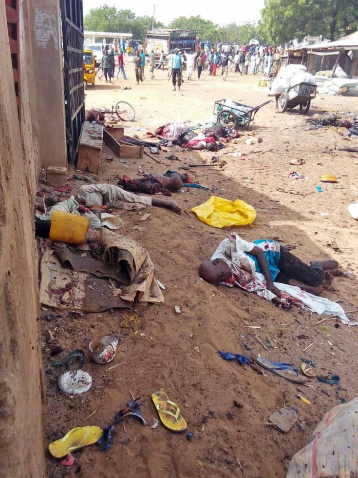 Victims of a suicide bomb attack that killed at least 14 people at a market in the northeastern town of Damaturu, July, 2015.