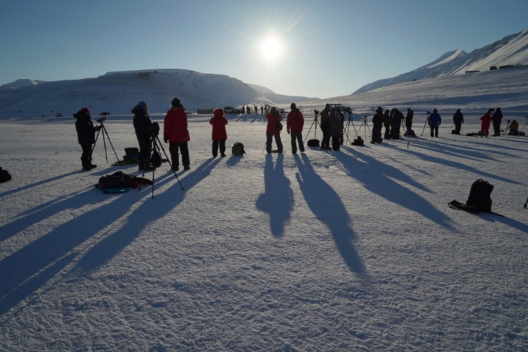 Watching the partial phase of a total solar eclipse in Longyearbyen, Svalbard, on March 20, 2015