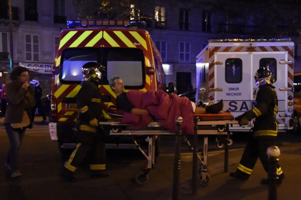 A victim of the November 13 attacks in Paris is carried on a stretcher.