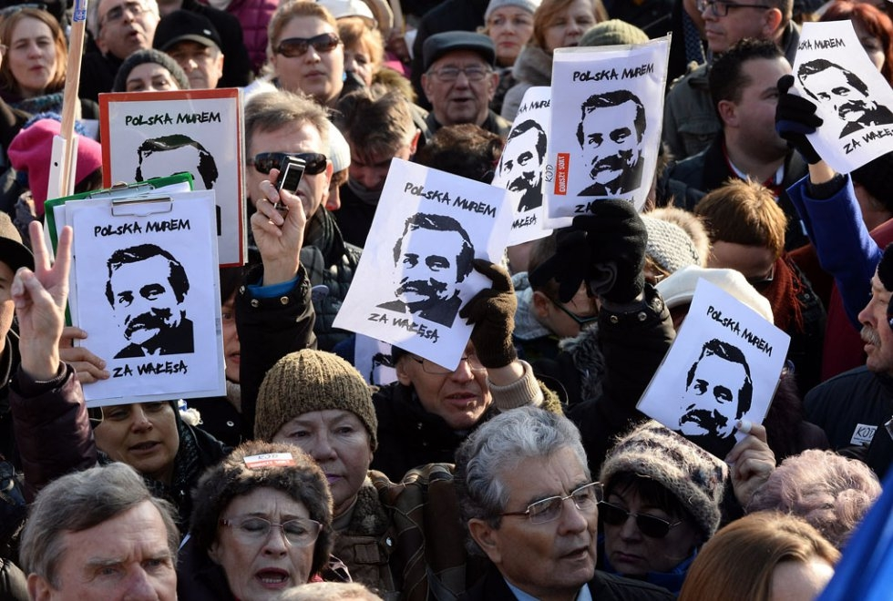 Protesters hold Lech Walesa posters at an anti-government rally on February 28, 2016 in Gdansk