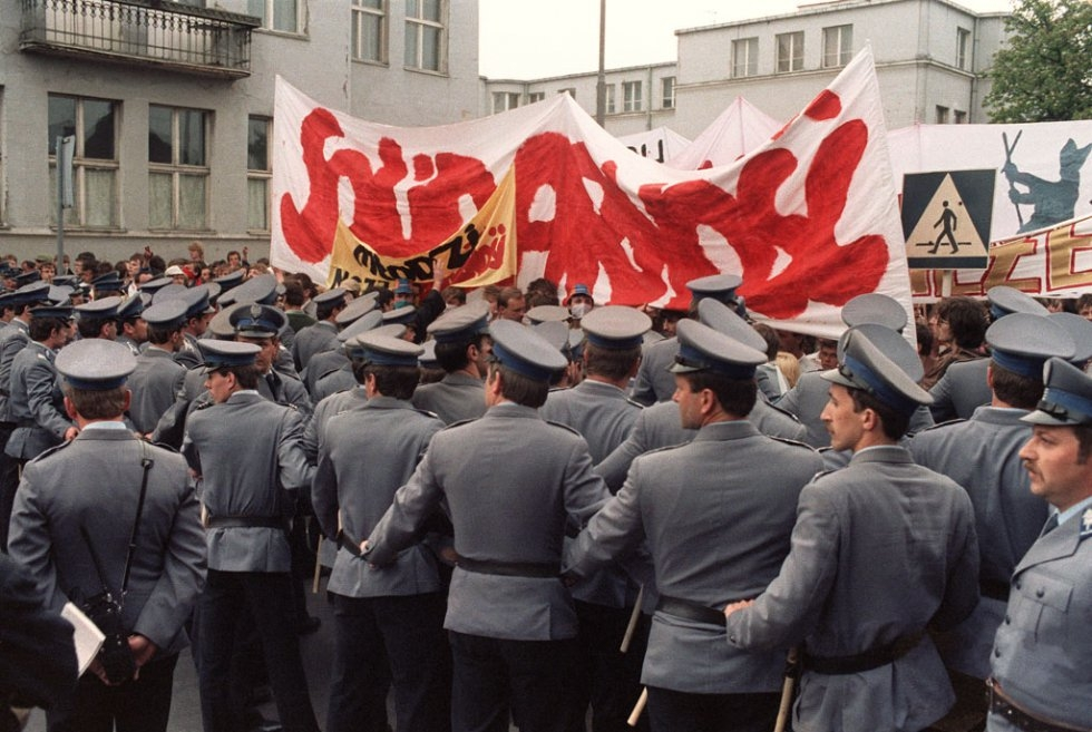 Polish policemen block the members of the outlawed Solidarity union during a rally on June 12, 1987 in Zaspa, near Gdansk